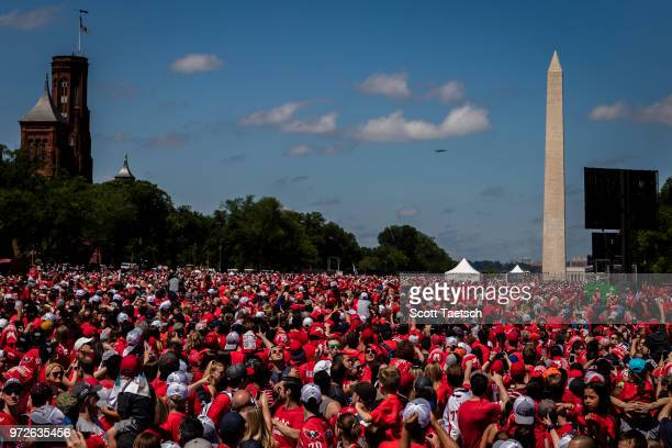 Fighting Falcons from the DC National Guard fly over the parade as fans watch from the Washington Capitals Victory Rally on June 12 2018 in...