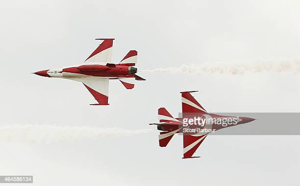 Fighting Falcons from the Republic of Singapore Air Force fly past each other as they perform at The Australian International Airshow on February 27...