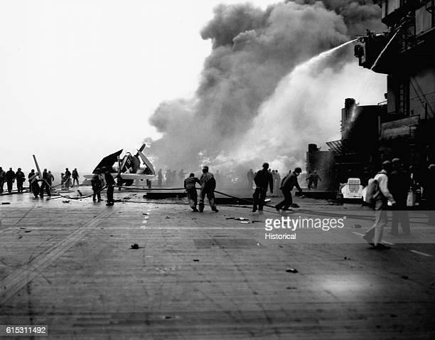 Fighting fire aboard the USS Saratoga resulting from Japanese plane attacks off Iwo Jima Volcano Islands ca 1945 | Location near Iwo Jima Volcano...