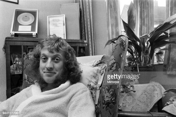 Fighting fit and ready to go that was pop star Noddy Holder leader singer of Slade relaxing at his parents house in Walsall after being discharged...