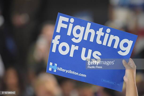 Fighting For Us sign held aloft in auditorium Democratic presidential candidate Hillary Rodham Clinton held a town hall meeting at Medgar Evers...