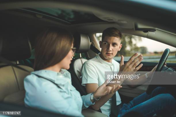 fighting in car - fighting stock pictures, royalty-free photos & images
