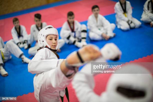 fighting in taekwondo - martial arts stock pictures, royalty-free photos & images