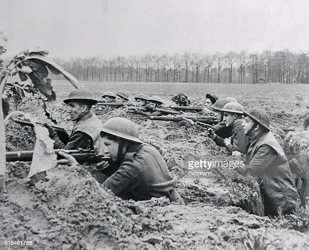 Fighting on the banks of the Maas near Venlo, this British infantry unit fights from a trench that is reminiscent of World War I. The tommies are...