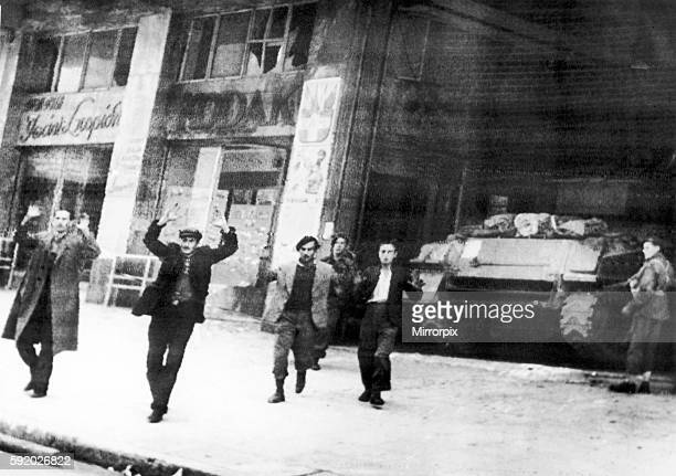 Fighting partisans of Greece, holding out in the EAM building in Athens, taken prisoner by British paratroopers during the Second World War. Circa...