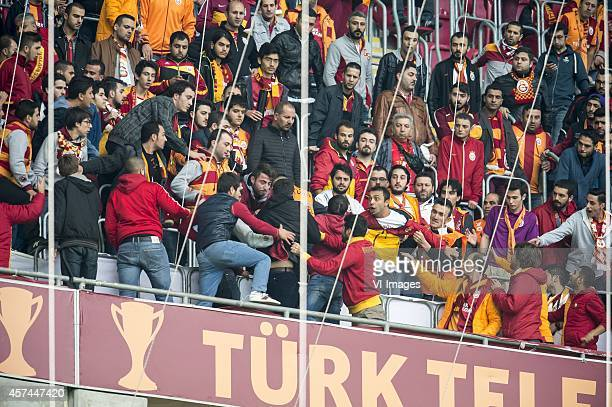 fighting supporters of Galatasaray during the Turkish SuperLig match between Galatasaray and Fenerbahce on October 18 2014 at the Turk Telekom Arena...