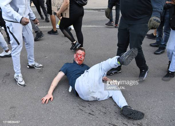 TOPSHOT Fights take place near Waterloo Station as protesters supporting the Black Lives Matter movement clash with opponents in central London on...