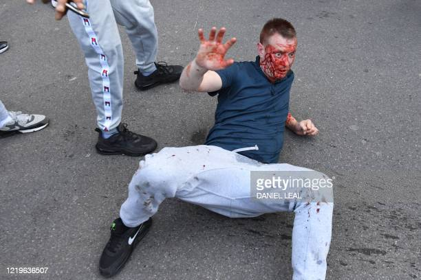 Fights take place near Waterloo Station as protesters supporting the Black Lives Matter movement clash with opponents in central London on June 13 in...