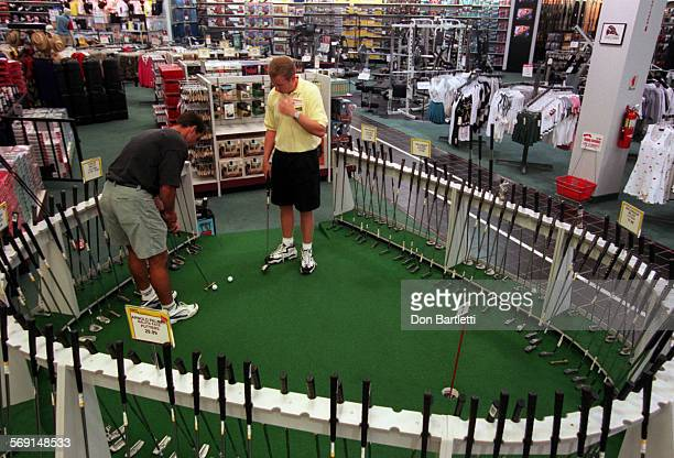 FIGolfPuttersDB8/11/97Irvine Jim VanNyhuis golf manager of Las Vegas Discount Golf within OshmanÕs Sporting Goods store in Irvine watches customer...