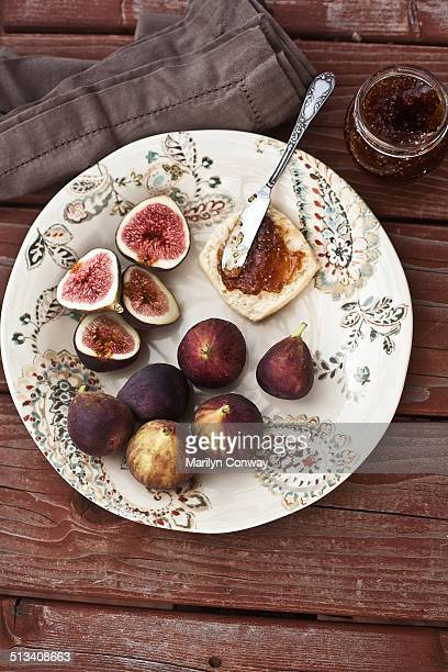 Figs and fig jam on picnic table