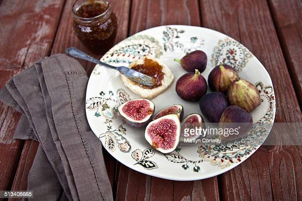 Figs and  jam on plate on picnic table