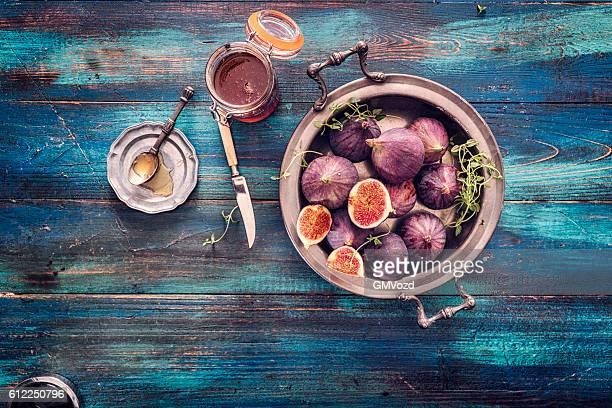 figs and sweet honey on wooden background - fig stock pictures, royalty-free photos & images