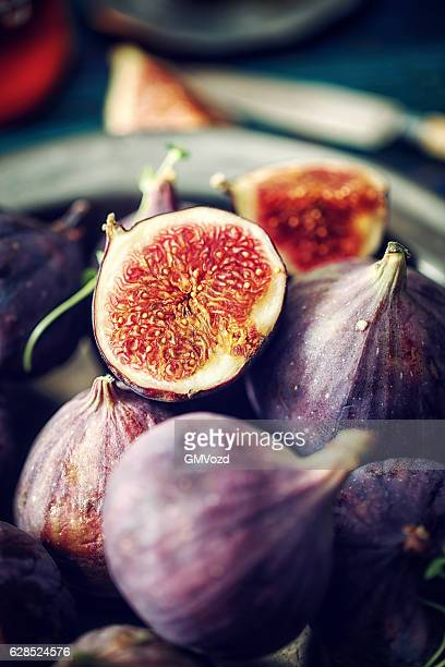 Figs and Sweet Honey on Wooden Background