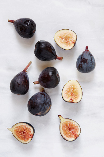 Figs lying on marble table - gettyimageskorea