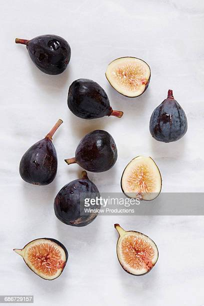 figs lying on marble table - fig stock pictures, royalty-free photos & images