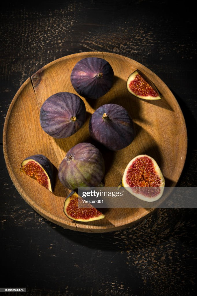 Figs On Wooden Plate Dark Wood High Res Stock Photo Getty Images