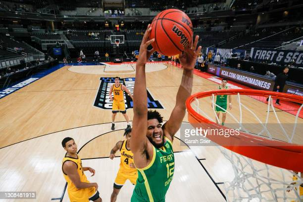 Figueroa of the Oregon Ducks dunks against the Iowa Hawkeyes in the second round game of the 2021 NCAA Men's Basketball Tournament at Bankers Life...