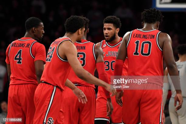 Figueroa of the St. John's Red Storm talks to his teammates in the second half against the Georgetown Hoyas during the first round of the Big East...