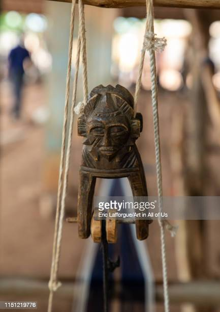 Figural heddle pulley in a traditional Senufo weaving factory, Savanes district, Waraniene, Ivory Coast on May 1, 2019 in Waraniene, Ivory Coast.