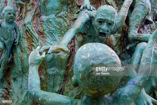 A figurative sculpture by artist Kenneth Treister is on display as part of a memorial depicting thousands of victims crawling into an open hand...