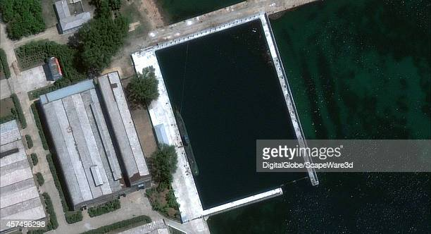 Figure 1 A DigitalGlobe image of the Sinpo South Shipyard on the east coast shows the newly identified submarine berthed within the facilitys secure...