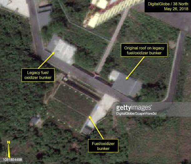 Figure 1B Original roof of fuel/oxidizer bunker at the launch pad smooth and flat in May 26 imagery Mandatory credit for all images DigitalGlobe/38...