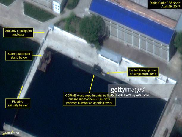 Figure 2 The GORAEclass ballistic missile submarine and submersible test barge remain in the secure boat basin Mandatory credit for all images...