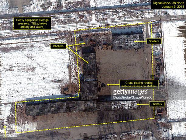 Figure 32 Several shelters were present many had already been covered A crane was working on placing roofing material or tarps on the remaining...