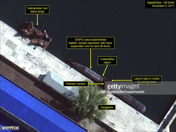 Figure 4 SINPOclass submarine and submersible test stand barge berthed in the secure boat basin Mandatory credit for all images DigitalGlobe/38 North...