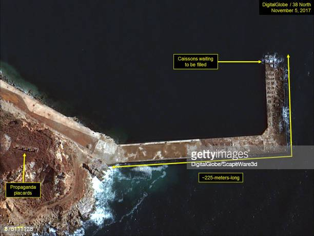 Figure 7 Construction of Lshaped pier continues Mandatory credit for all images DigitalGlobe/38 North via Getty Images