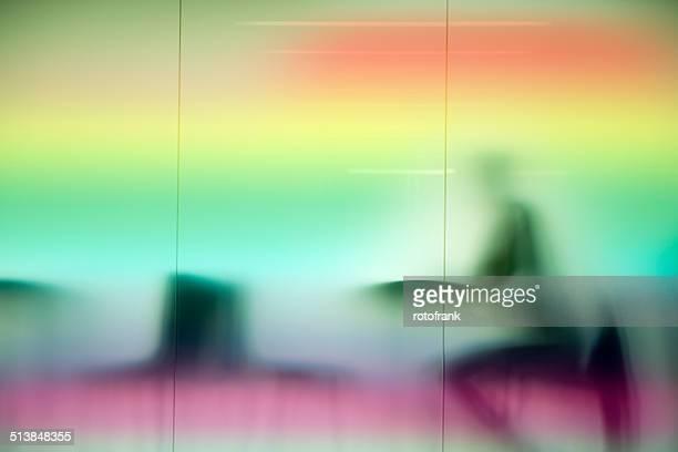 Figure behind opal glass pane