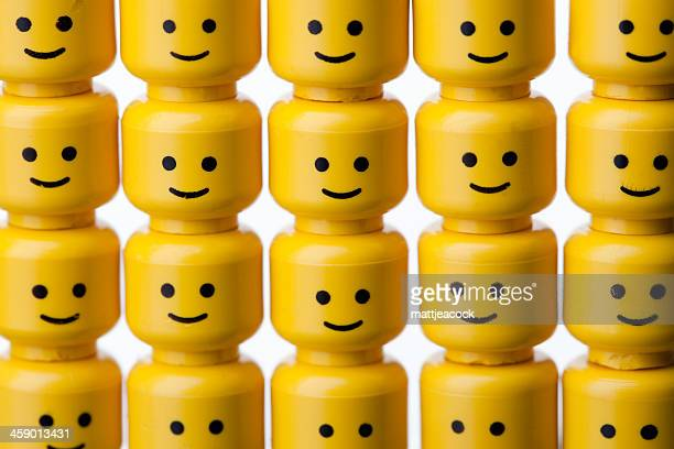 lego figure heads - repetition stock pictures, royalty-free photos & images