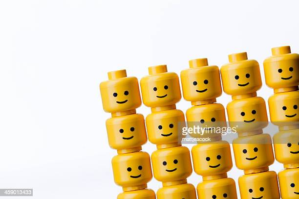 lego figure heads - lego stock pictures, royalty-free photos & images