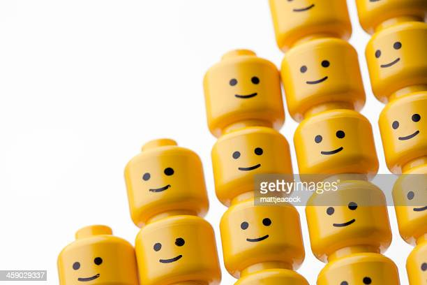 lego figure heads - lego stock photos and pictures