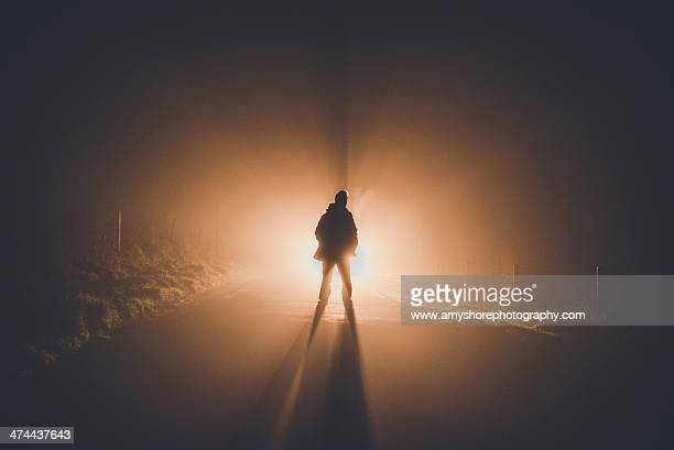 figure in fog - back lit stock pictures, royalty-free photos & images