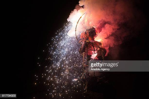 A figure is burned during the Saturday of Glory as part of Holy Week celebration in Mexico City Mexico on March 27 2016 Figures made of PapierMache...