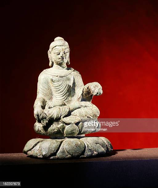Figure of a Buddha from northern India, It was brought to the island port of Helgo, Sweden, during the migration period and clearly demonstrates the...