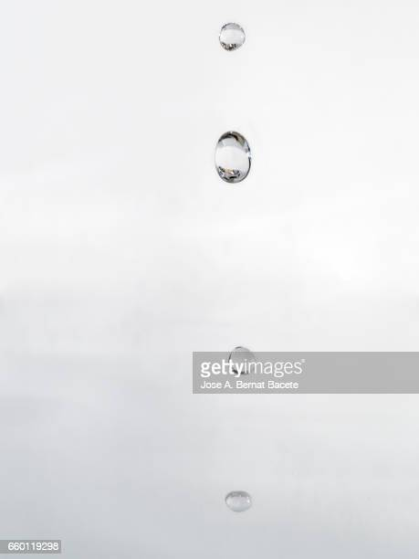 Figure of a water drop on having struck on a water surface with a white bottom