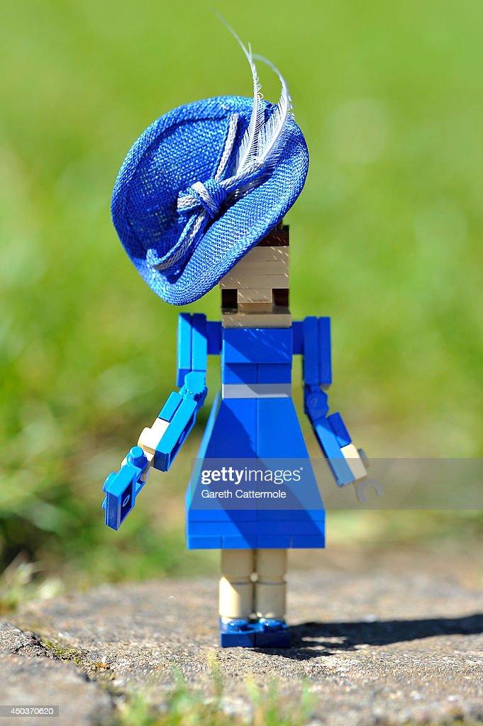 A LEGO figure of Catherine, Duchess of Cambridge stands outside a LEGO Buckingham Palace wearing designer hats by Rachel Trevor-Morgan, The Queen's milliner ahead of Royal Ascot at LEGOLAND Windsor on June 10, 2014 in Windsor, England.