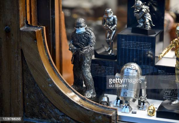 Figure of Chewbacca from the Star Wars films, is pictured wearing a face mask, in the window display of a jewellery store in Durham, northeast...