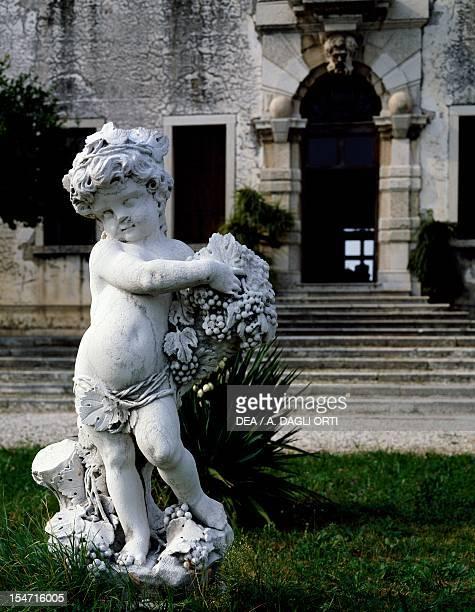 Figure of Child, Istrian stone Villa park-Rezzonico Borella, Bassano del Grappa, Veneto. Italy, 18th century.