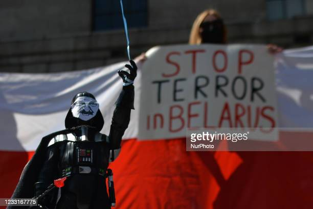 Figure of Darth Vader with the face of Belarusian President Alexander Lukashenko is seen as members of the Belarussian community in Ireland take part...