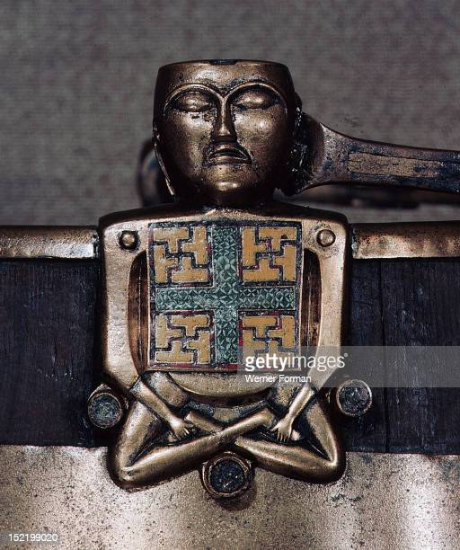 A figure of Hiberno Saxon origin on the handle of a bucket with swastika symbols of Thor Norway Viking 1st half of 9th c