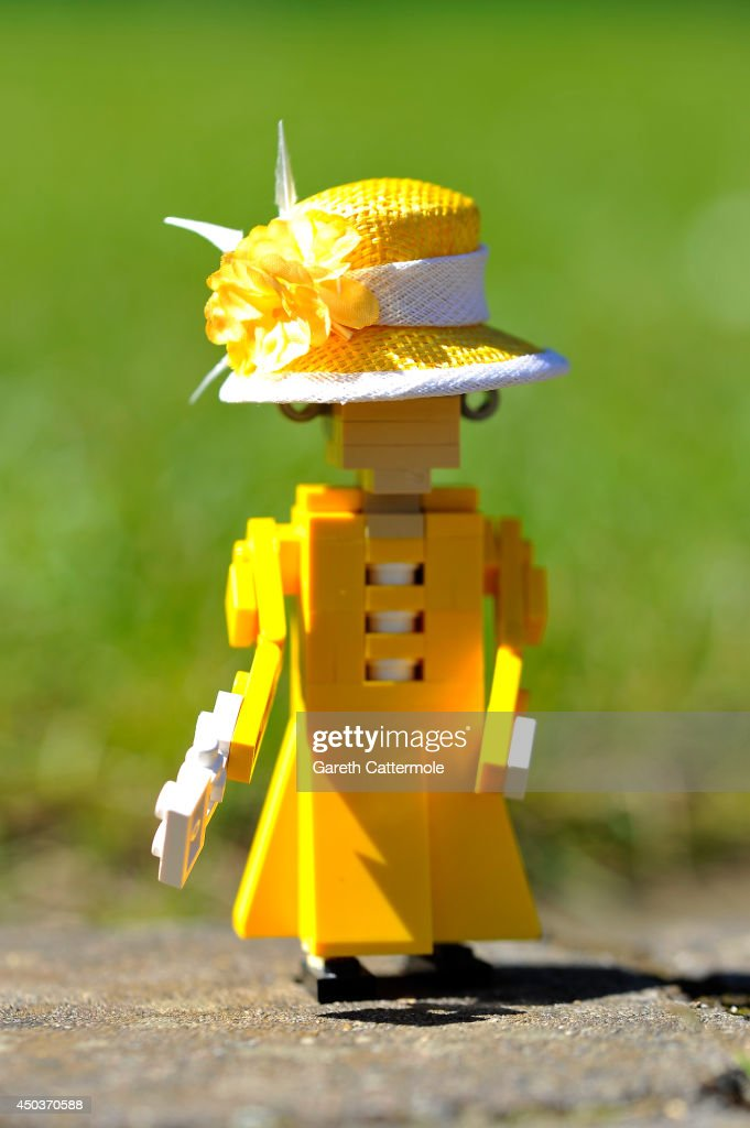 A LEGO figure of Queen Elizabeth II stands outside a LEGO Buckingham Palace wearing a designer hat by Rachel Trevor-Morgan, The Queen's milliner ahead of Royal Ascot at LEGOLAND Windsor on June 10, 2014 in Windsor, England.