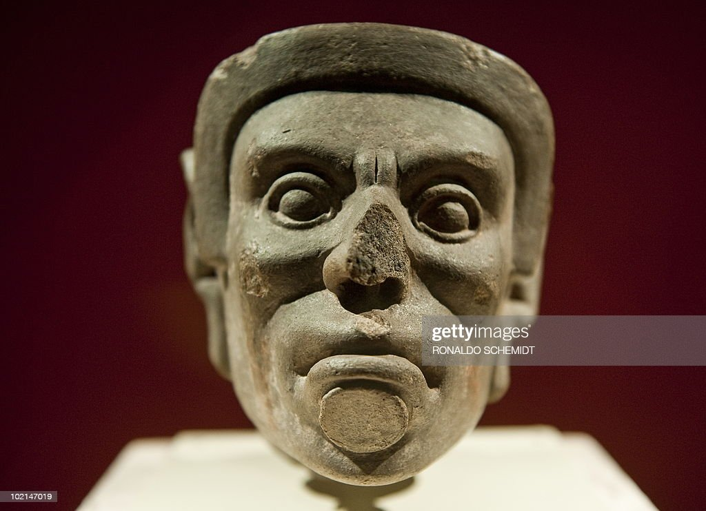 A figure of stone is displayed during a presentation for press of the exhibition 'Moctezuma II' at the Templo Mayor museum, in Mexico City, on June 16, 2010. AFP PHOTO/Ronaldo Schemidt