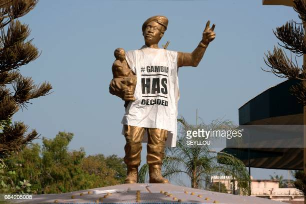 Figure of the Arch 22 monument to mark the July 22, 1994 bloodless coup led by former President Yahya Jammeh is draped with a shirt-shaped banner...