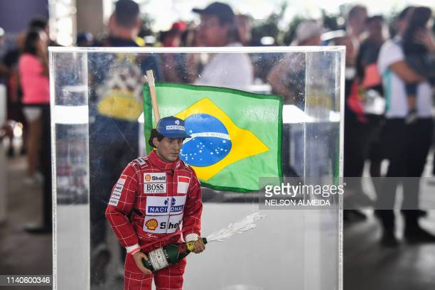 TOPSHOT A figure of the Brazilian driver Ayrton Senna is pictured at the exhibition that carries his name as part of the 'Senna Day' held at...