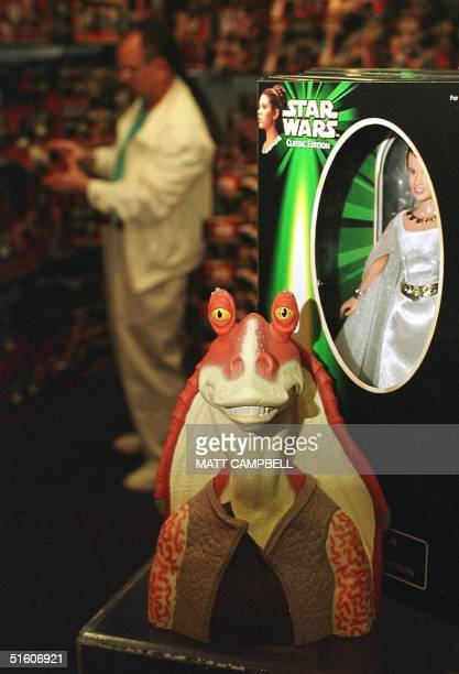 A figure of the character called Jar Jar Binks from the new Star Wars movie The Phantom Menace sits next to a figure of Princess Leia from the...