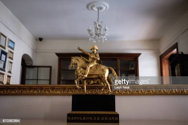 Figure of the French Emperor Napoleon Bonaparte, who died in exile on the island, is seen in the Consulate Hotel on October 22, 2017 in Jamestown,...