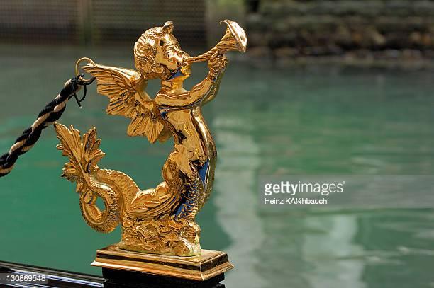 Figure on a gondola, golden angel with trombone, Venice, Venetia, Italy